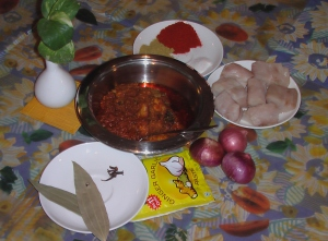 Prepared fish Curry with Some of the Ingredients
